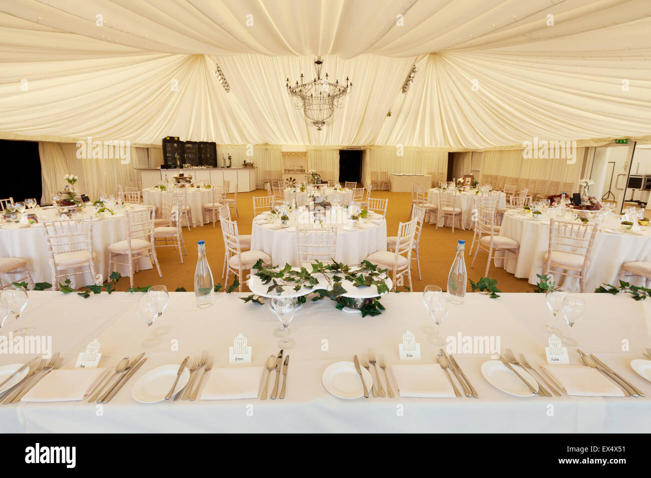 Wedding reception tables and place setting laid, UK - Stock Image