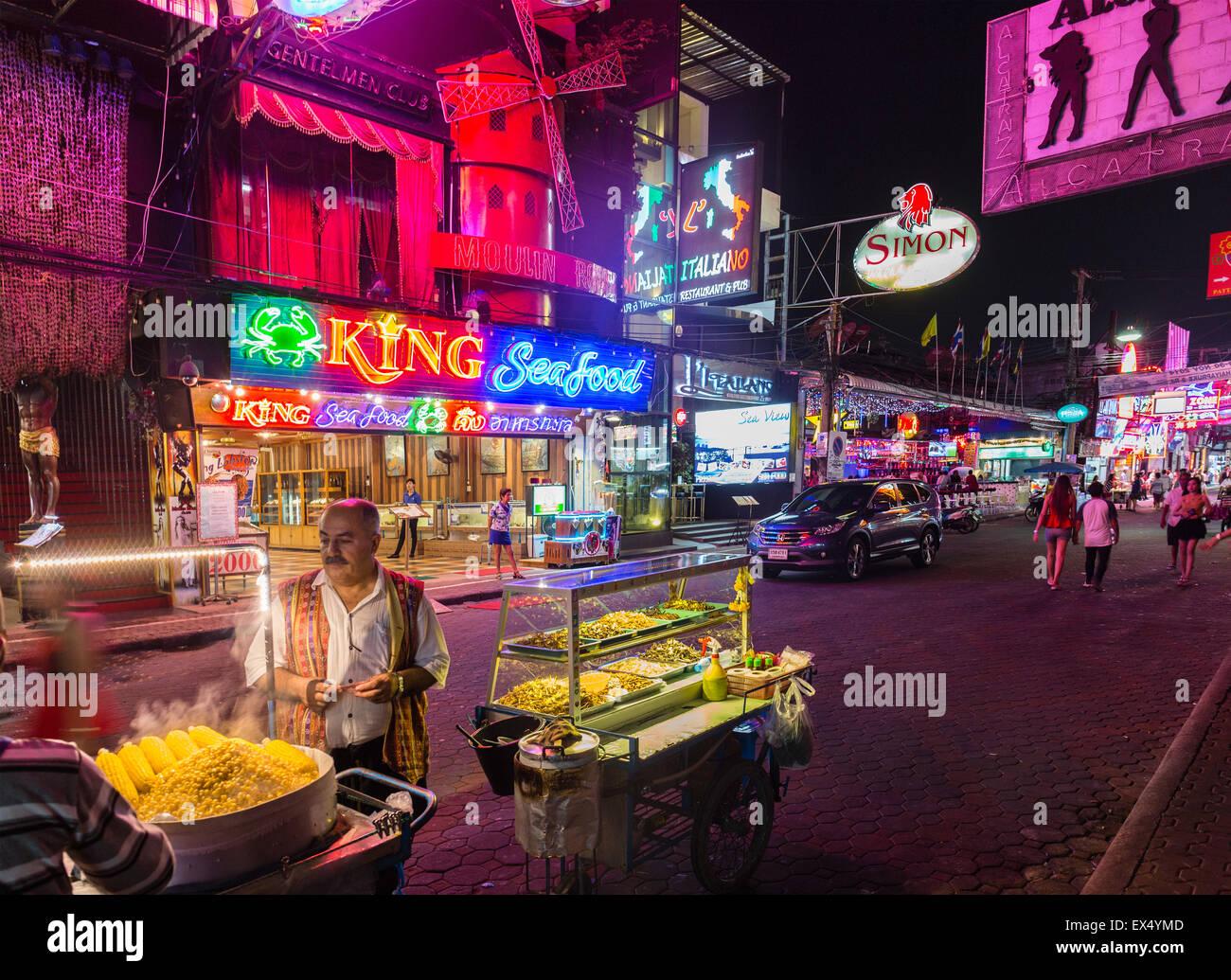 Walking Street, vendor, nightlife, bars, neon signs, Pattaya, Chon Buri Province, Thailand - Stock Image