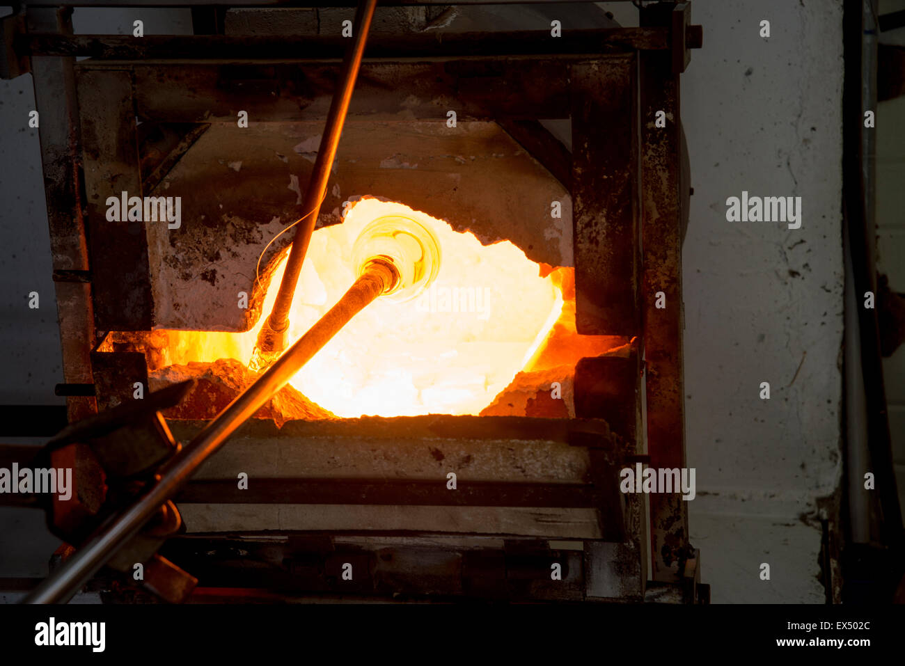 Glassmaker's workshop the glass is in the oven to melt before forming - Stock Image