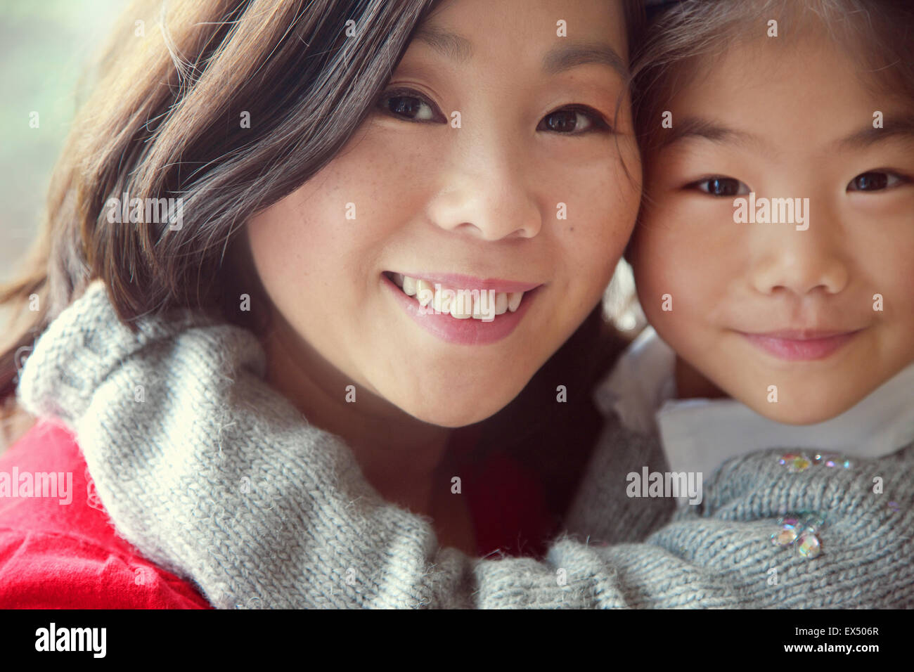 Mother and Daughter Embracing, Close-up view Stock Photo
