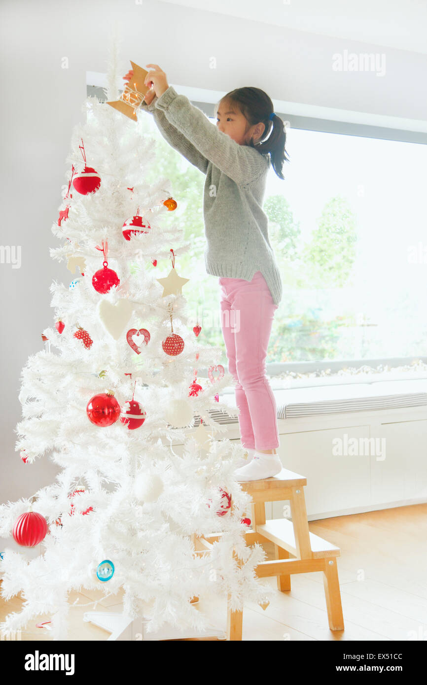 Young Girl Decorating Christmas Tree Stock Photo