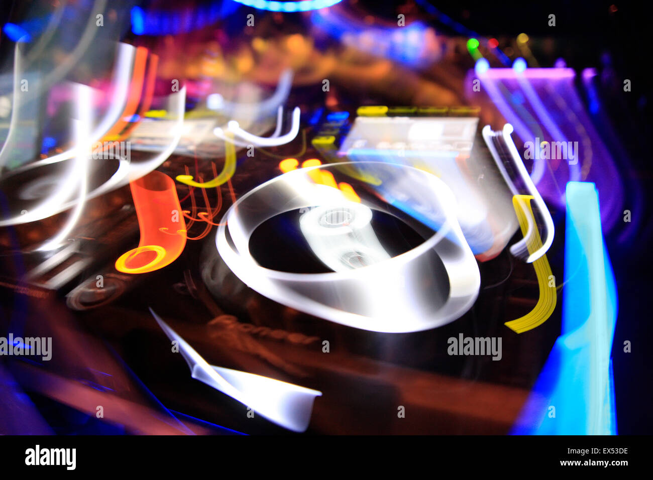 Atmospheric motion image of a deck equipment / sound mixing devices. Athens nightclub, Greece. - Stock Image