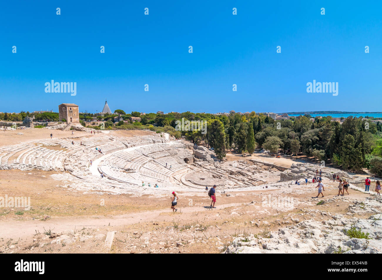 SYRACUSE, ITALY - AUGUST 18, 2014: tourists visit ancient Greek theater in Syracuse, Italy. - Stock Image