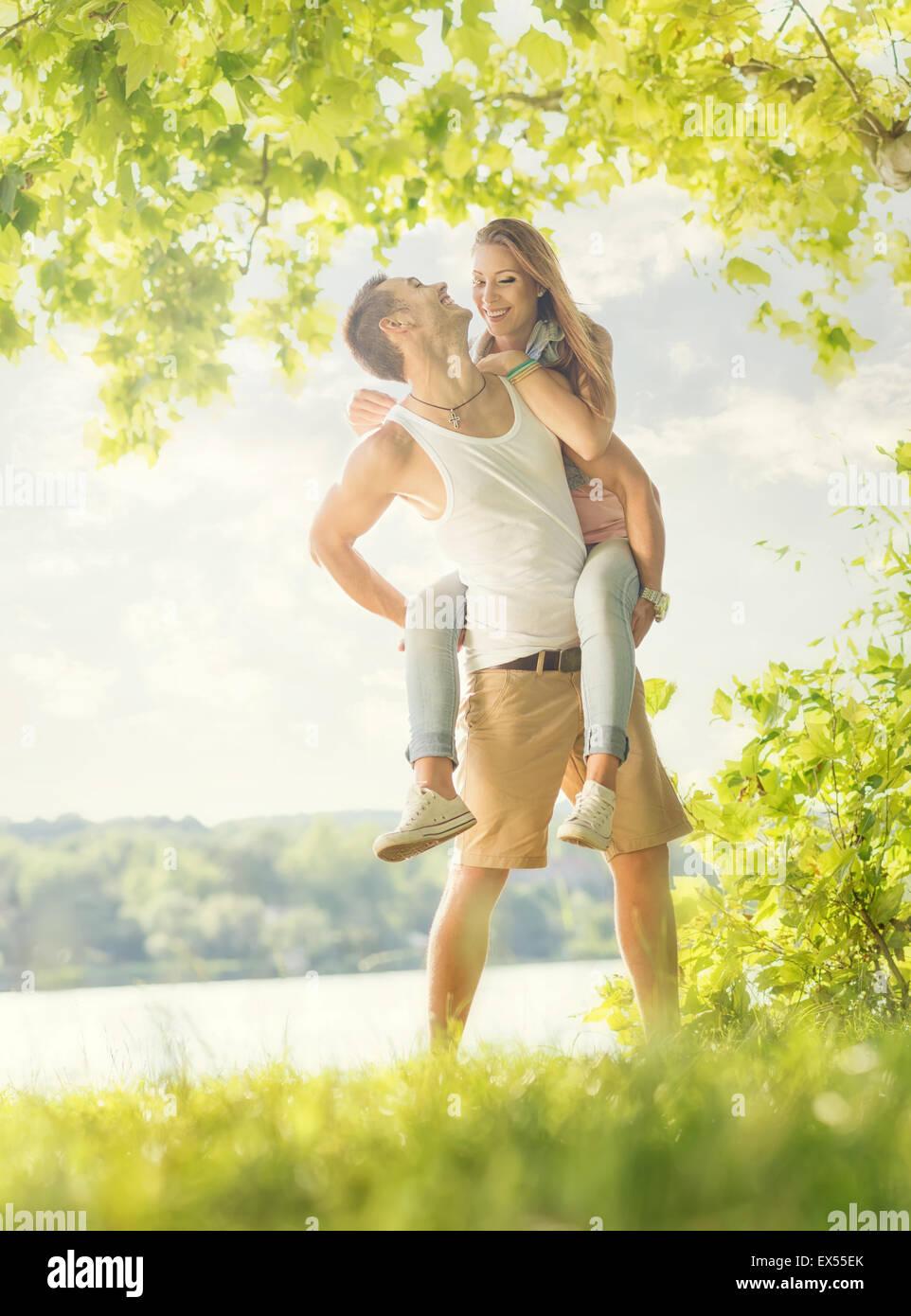 Couple in love on the lake, hug - Stock Image