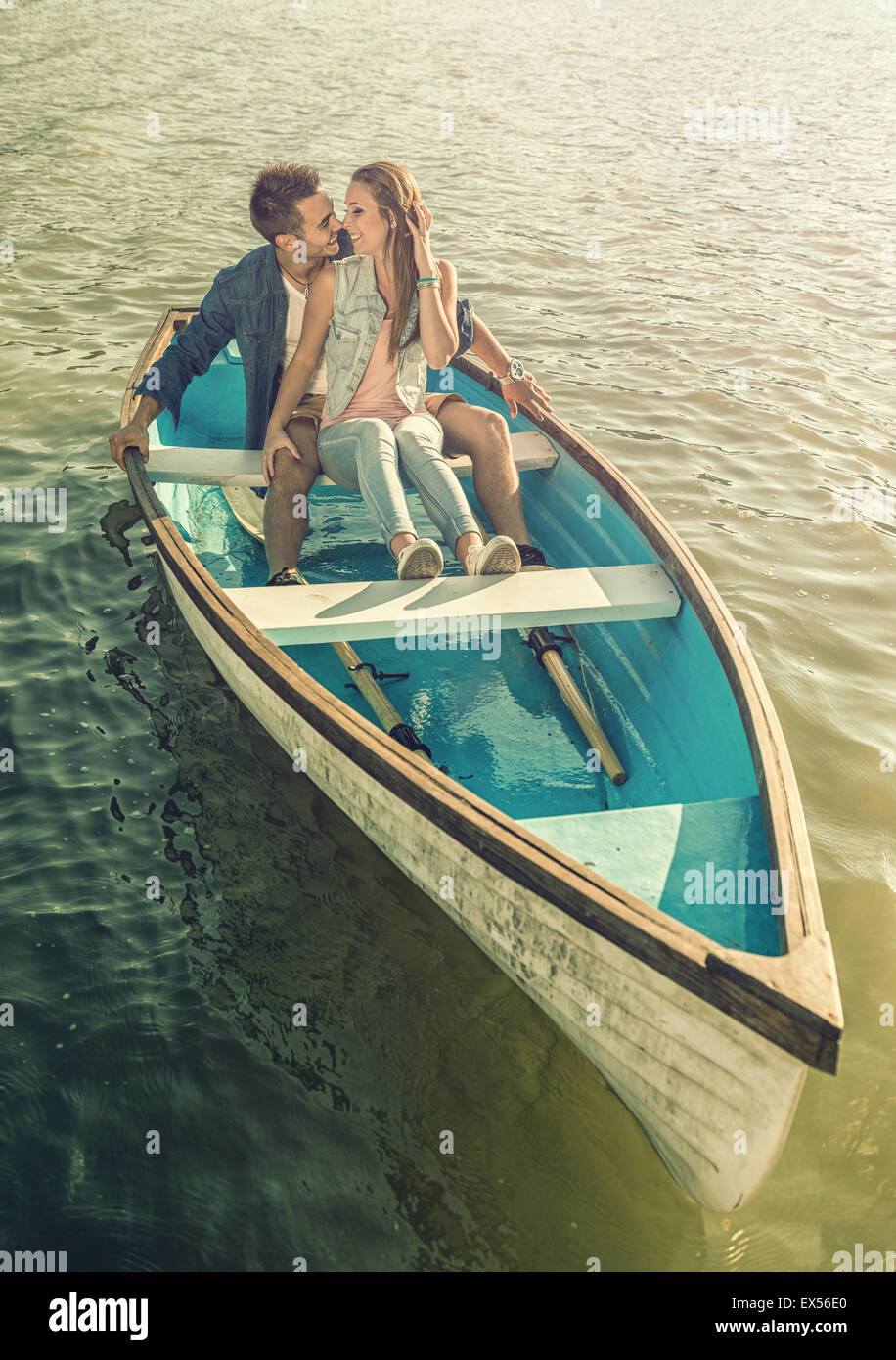 Couple in love on the boat - kissing - Stock Image