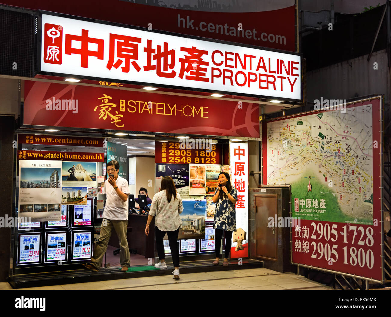 Properties for sale in an real estate agent window Hong Kong island hksar China Chinese - Stock Image