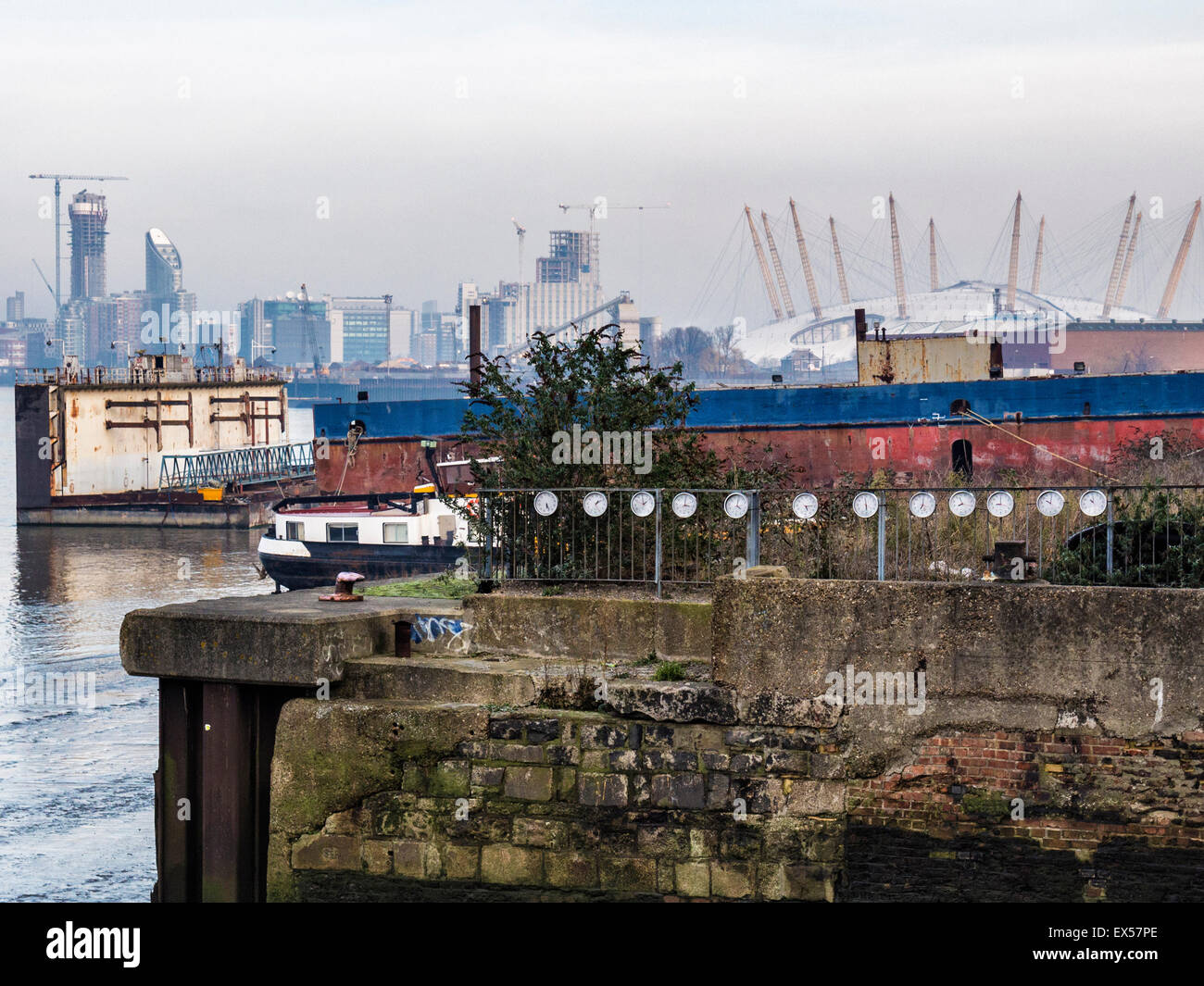 London Greenwich Thames riverside, urban art clocks, the O2 Arena and distant buildings - Stock Image