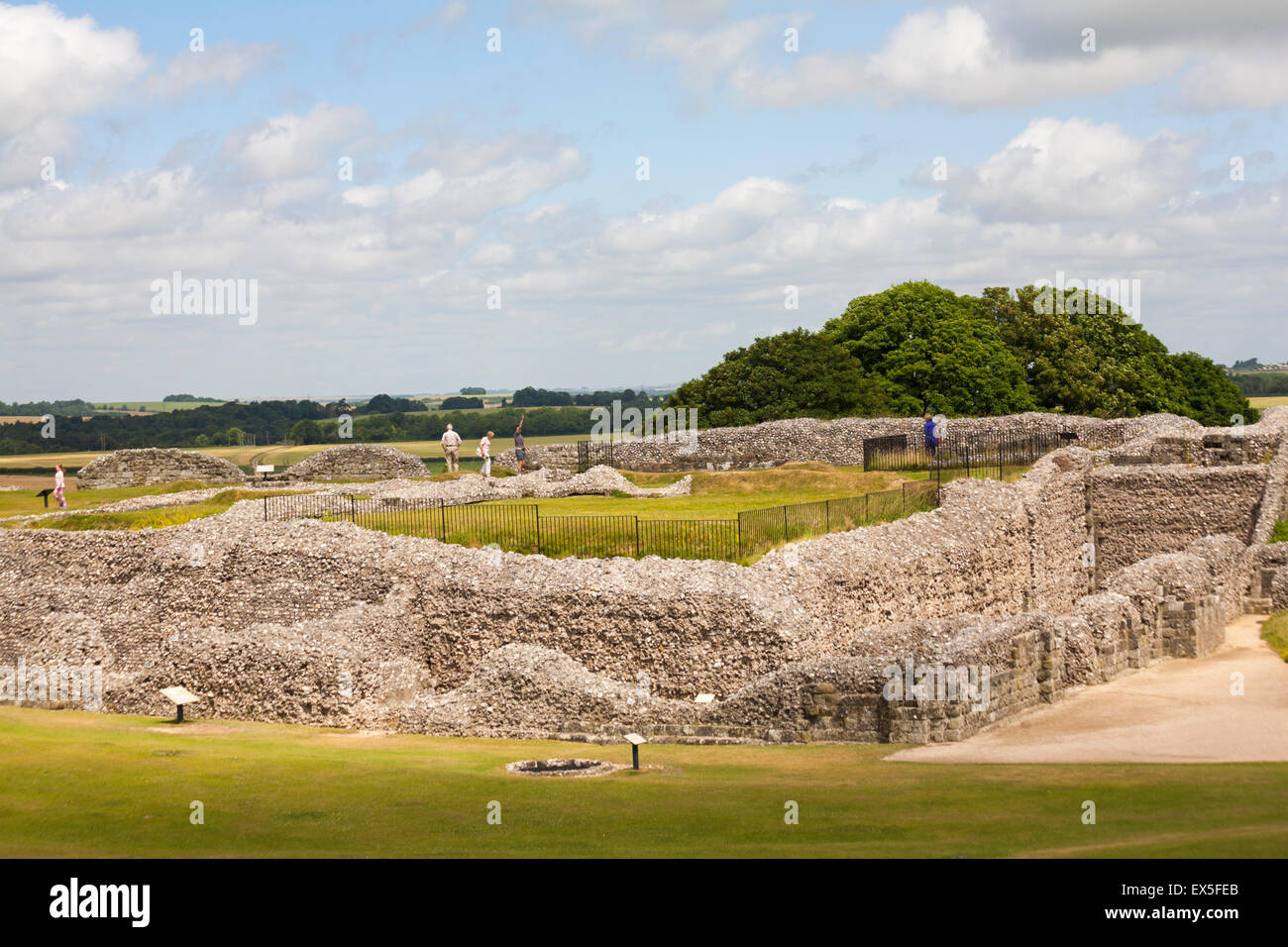 Visitors exploring at Old Sarum, near Salisbury, Wiltshire in July Stock Photo