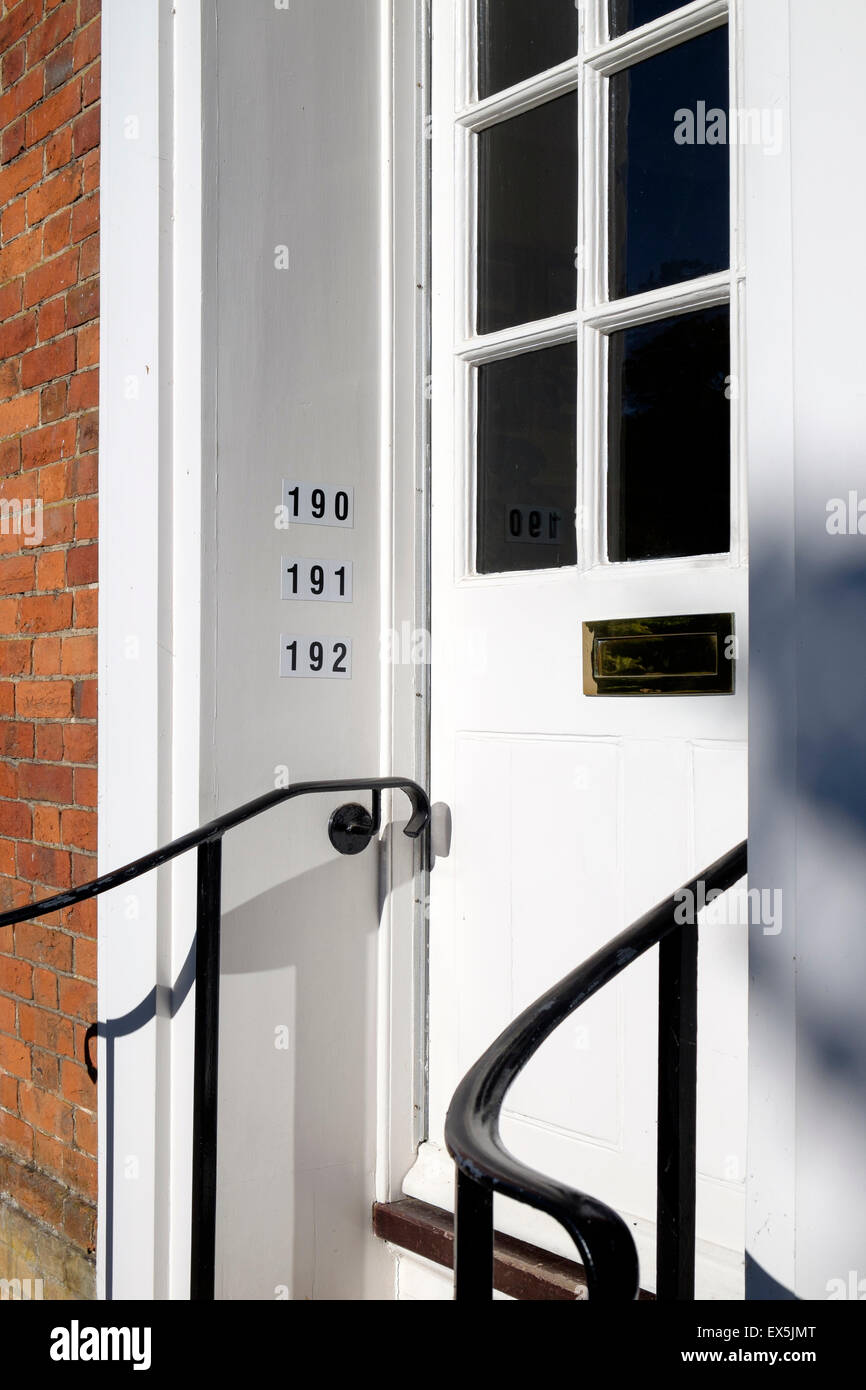 Numbers Of Flats Or Apartments On Wall At Communal Entrance Door   Stock  Image