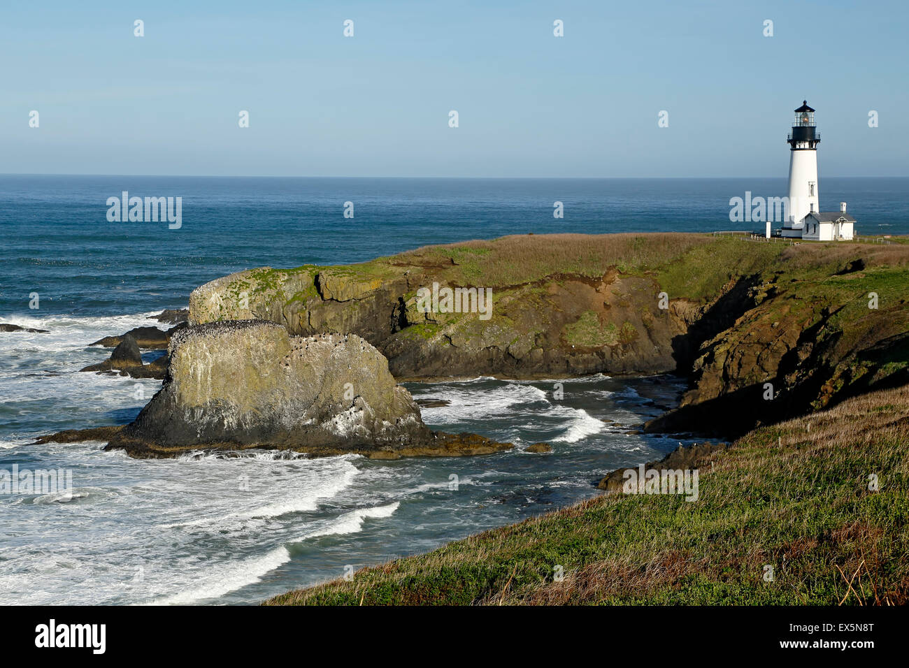 Historic Yaquina Head Lighthouse and rocky headland, Yaquina Head Outstanding Natural Area, Newport, Oregon USA - Stock Image