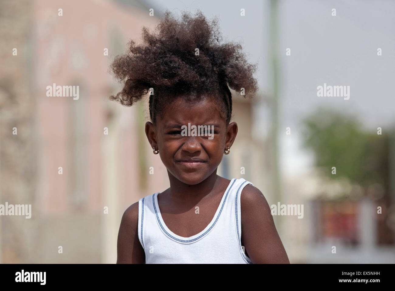 Close up portrait of Creole girl with frizzy hair on the island Boa Vista, Cape Verde / Cabo Verde, Western Africa - Stock Image