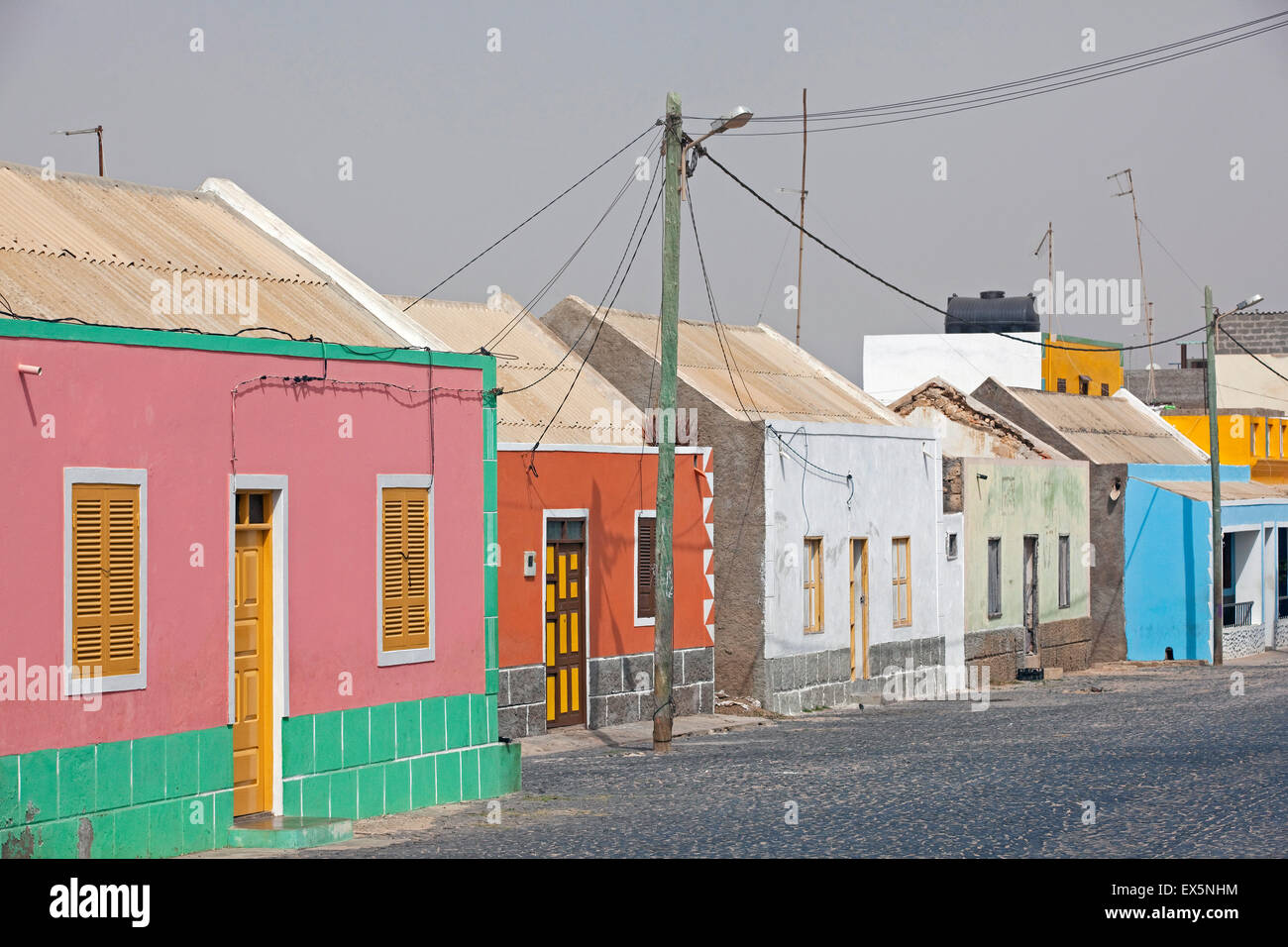 Street with colourful houses in the village Rabil on the island Boa Vista, Cape Verde / Cabo Verde, Western Africa Stock Photo