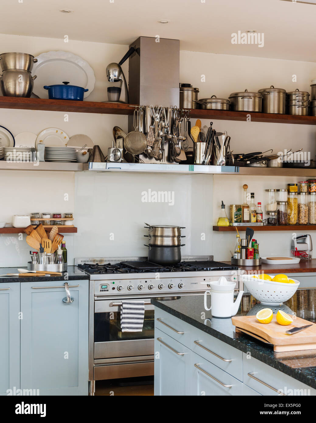 Open Shelving In Bright Airy Kitchen With Range Cooker And Granite