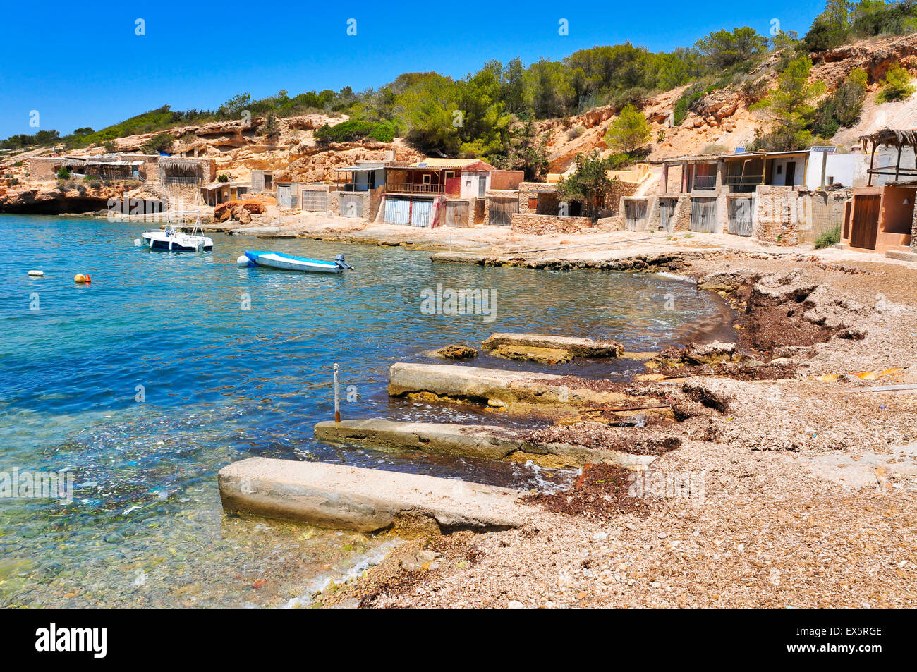 a view of the Cala Corral cove in Ibiza Island, Spain, with its traditional fishermen shelters - Stock Image