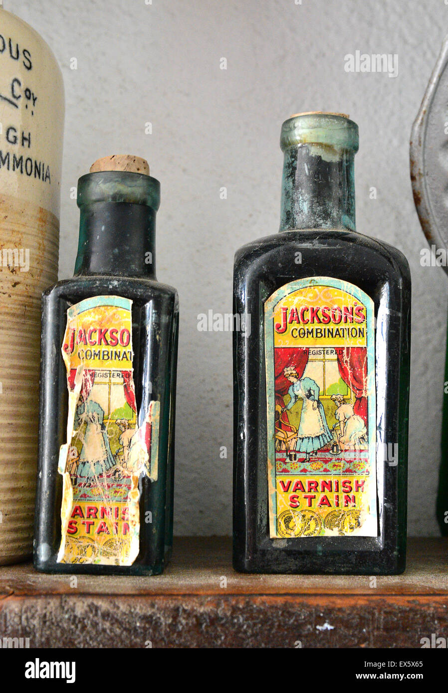 Old bottles of Jackson's combination Varnish Stain on display at the Ulster American Folk Park - Stock Image