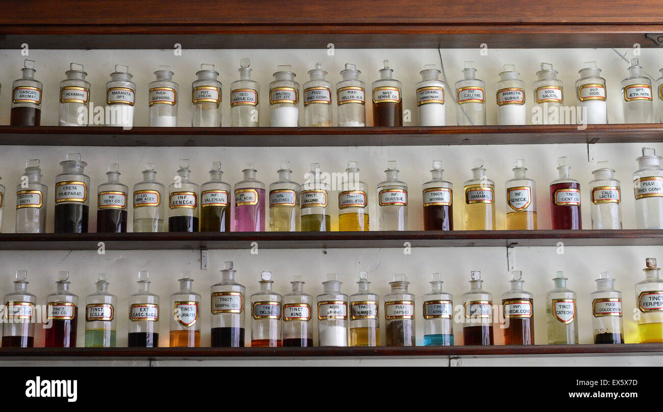 Display of early 20th century jars for ailment cures on display at the Ulster American Folk Park - Stock Image