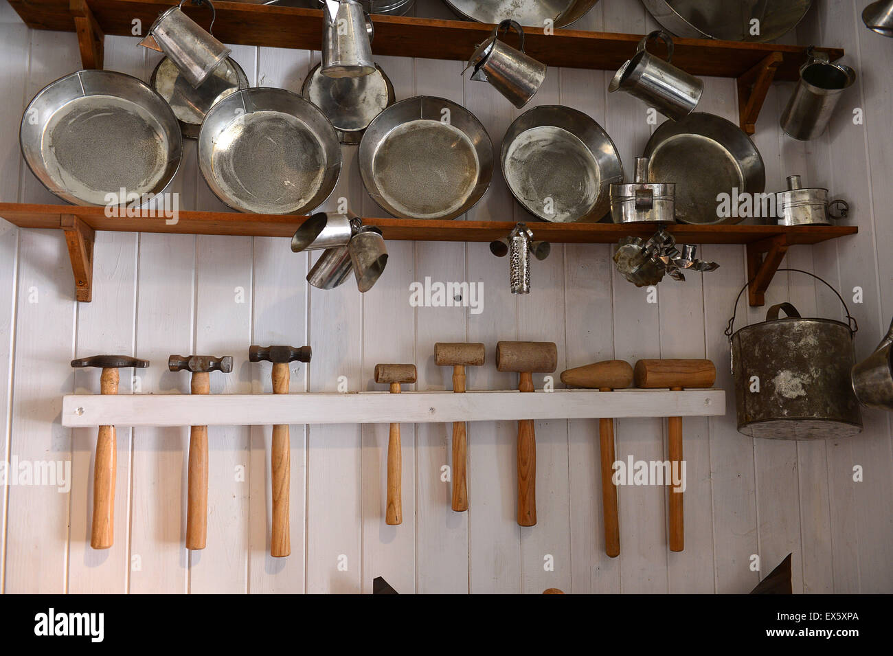 Coffee pots, pans, and jugs on display at tinsmiths shop in the Ulster American Folk Park - Stock Image