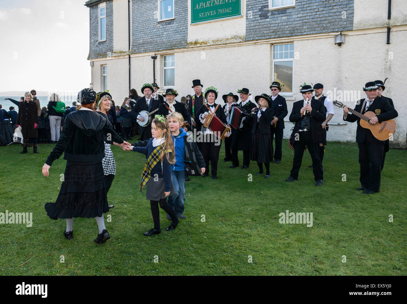 A band playing and children dancing during Feast day celebrations in St.Ives, Cornwall, England, UK - Stock Image