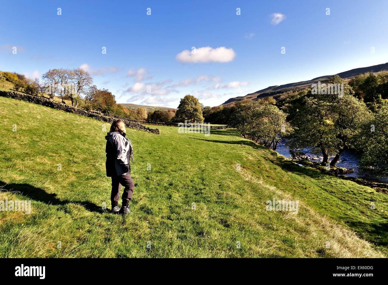 Single female rambler in Muker Swaledale Yorkshire - Stock Image