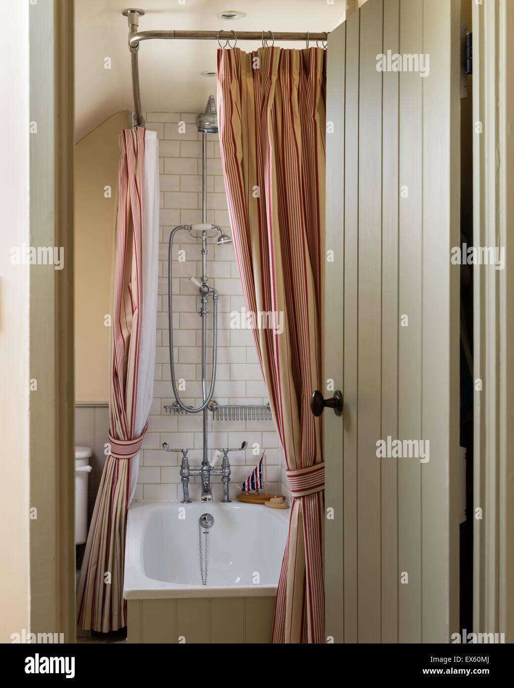 View Through Open Door To Bathroom The Shower Curtain Is