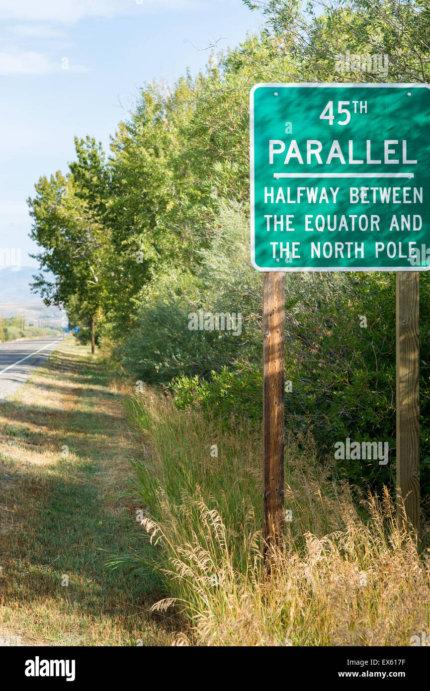 Highway road sign reading 45th Parallel, the halfway point between the Equator and the North Pole - Stock Image