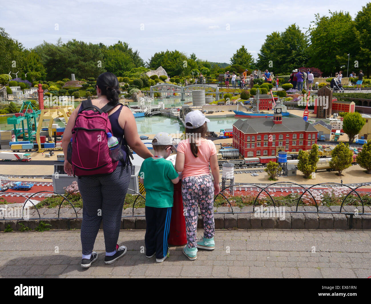 Visitors to Legoland Windsor admire the detailed models of famous landmarks from around the world made from Lego - Stock Image