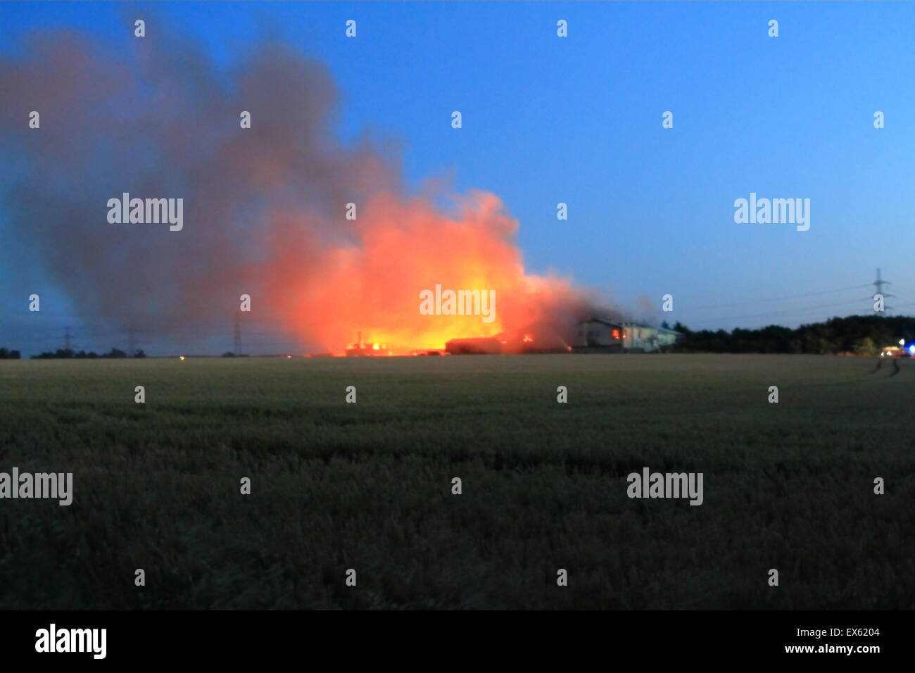 Rainham, London, UK. Tuesday 7th July 2015. Over 80 Firefighters tackle blaze in a pallet Yard in Rainham. 12 Fire Stock Photo