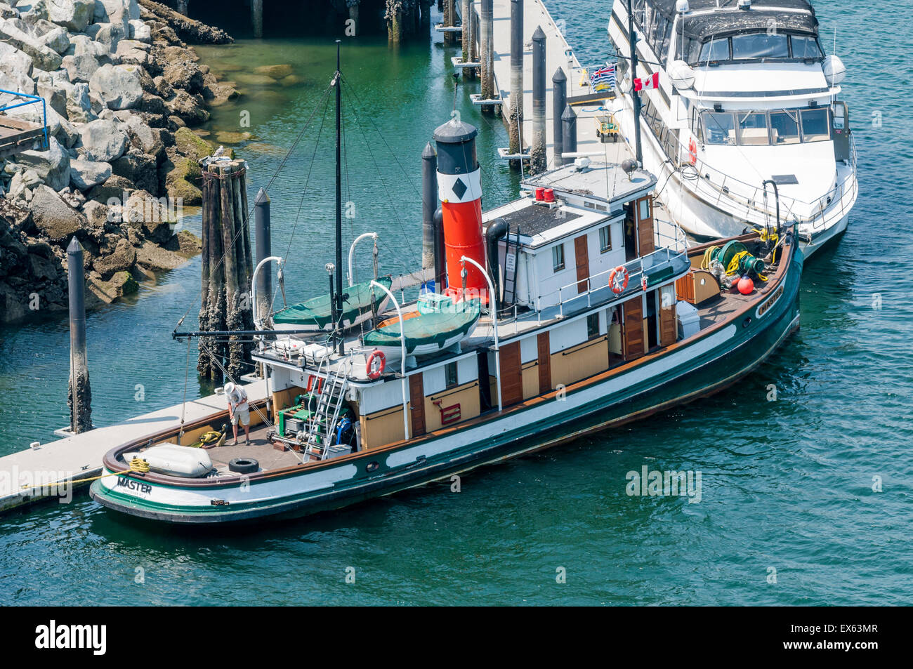 Steam powered tug, The Master, Granville Island dock, Vancouver, British Columbia, Canada - Stock Image