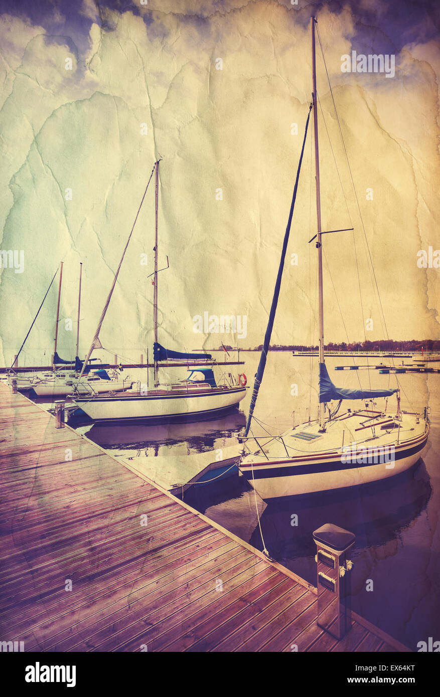 Retro old paper postcard with sailing boats at wooden pier. - Stock Image