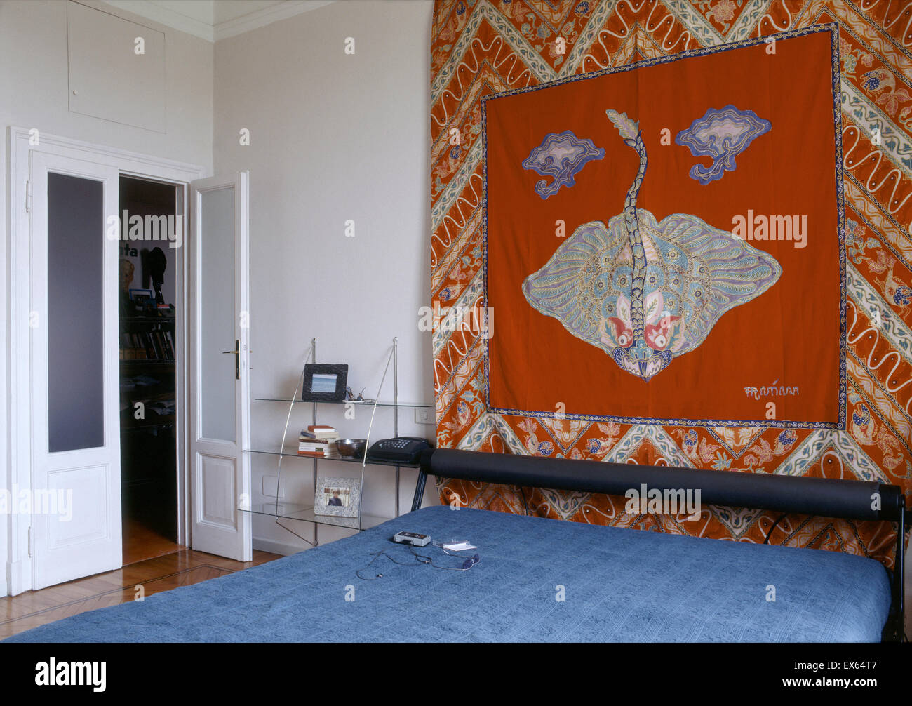 interior view of modern bedroom and red arras - Stock Image