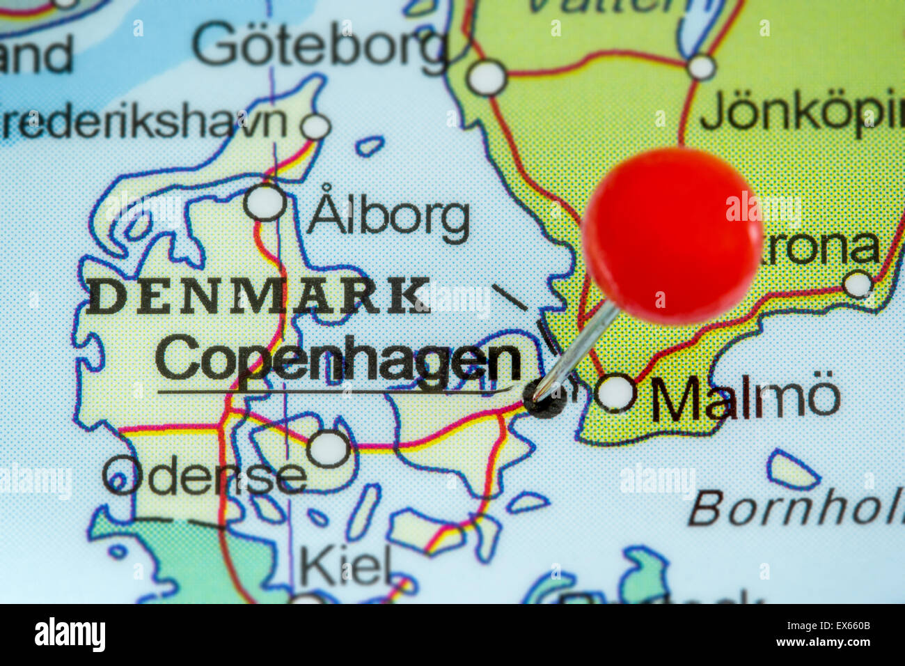Close-up of a red pushpin on a map of Copenhagen, Denmark - Stock Image