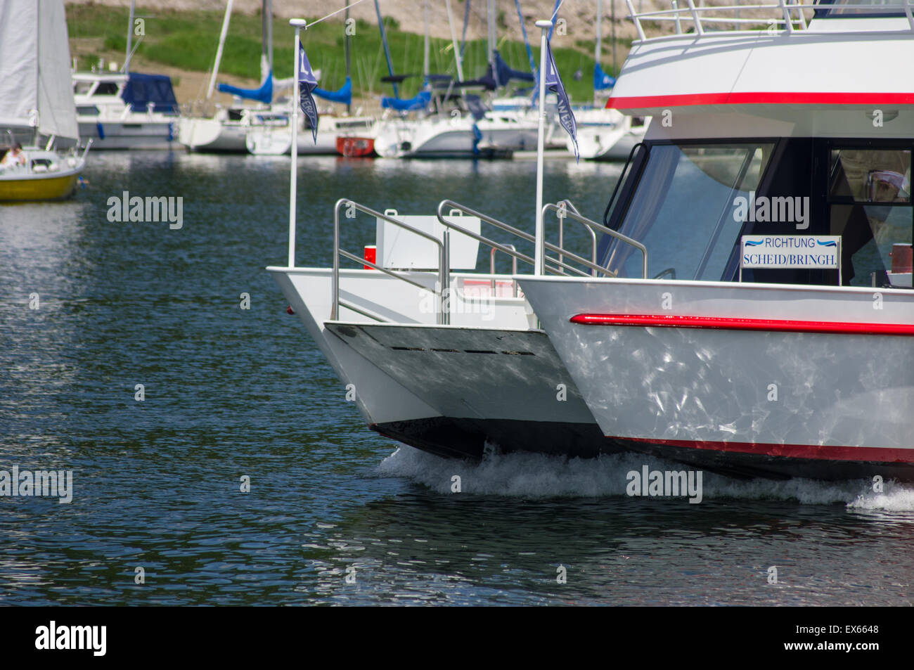 Passenger boat cutting through the water on Lake Edersee in Germany. - Stock Image
