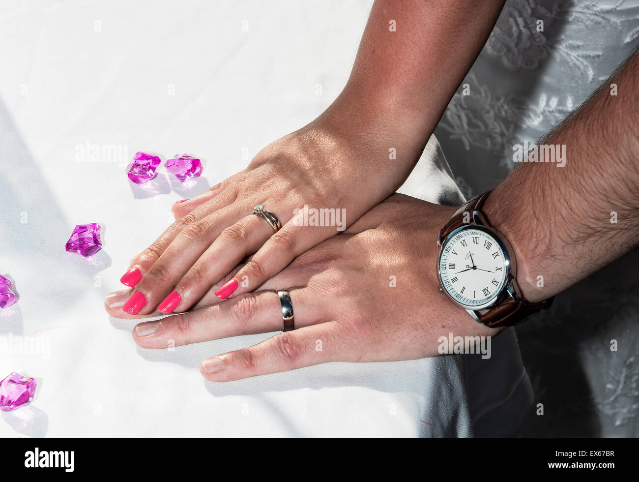 Bride and Groom Showing off their wedding rings Stock Photo