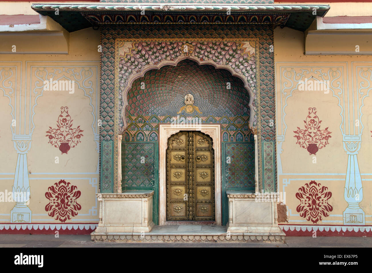 Brass gate with delicate wall paintings in the courtyard of the Chandra Mahal City Palace, Jaipur, Rajasthan, India - Stock Image