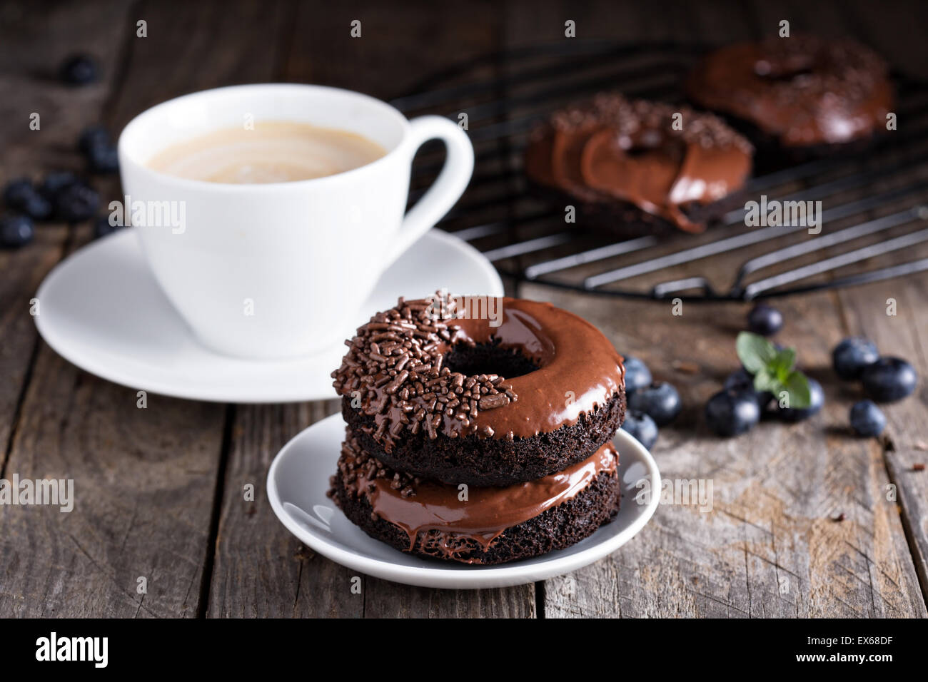 Chocolate gluten free donuts with coffee and blueberries - Stock Image