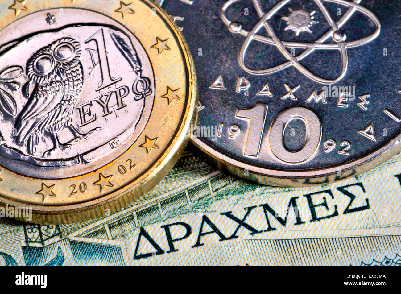 Greek currency - drachmas and 1 Euro on a 1980s 50 Drachma note - Stock Image