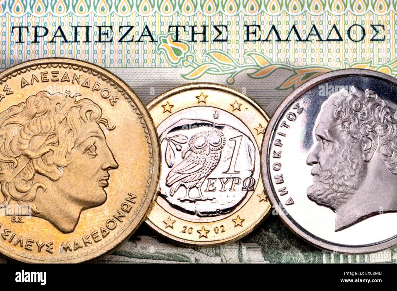Greek currency - drachmas and Euro. Alexander the Great (100 drachmas) and Demokritus (10 drachmas) and 1 Euro coin. - Stock Image