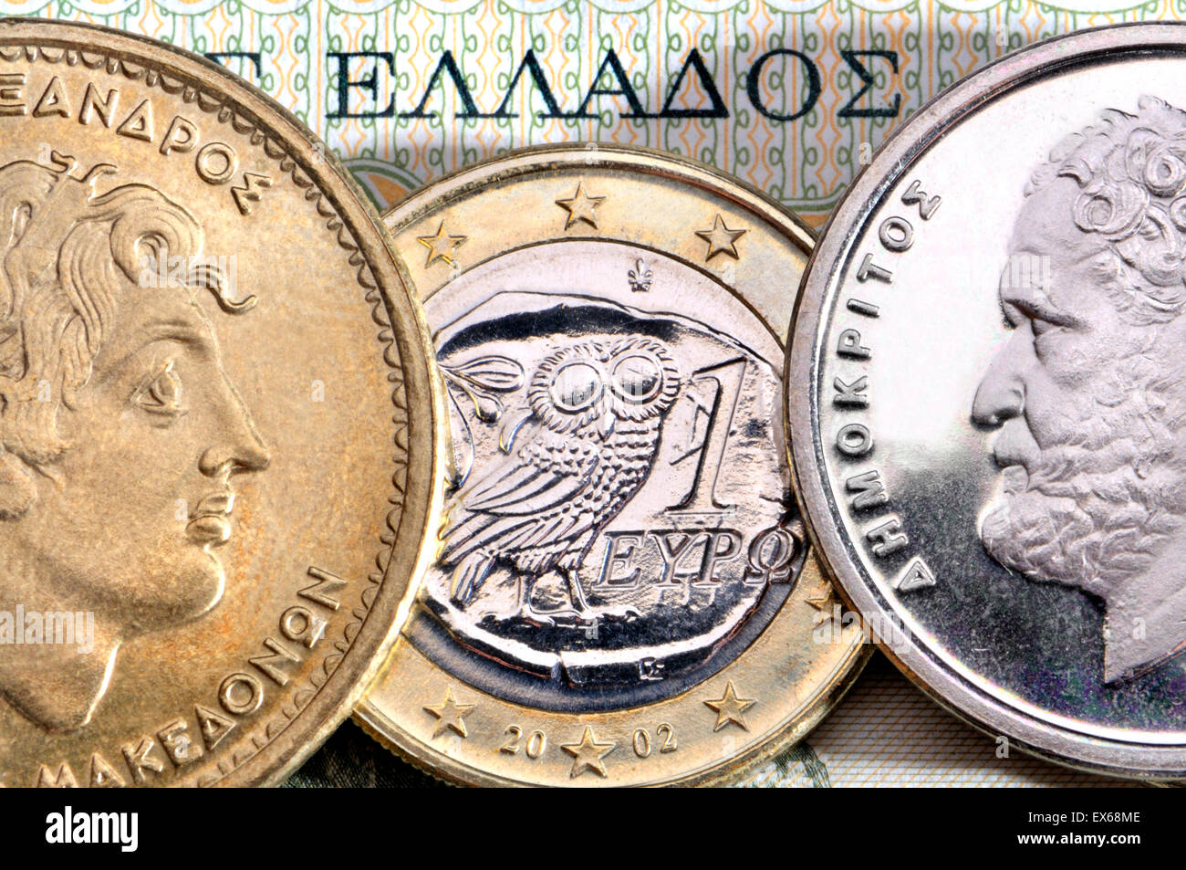 Greek currency - drachmas and Euro. Alexander the Great (100 drachmas) and Demokritus (10 drachmas) and 1 Euro coin - Stock Image