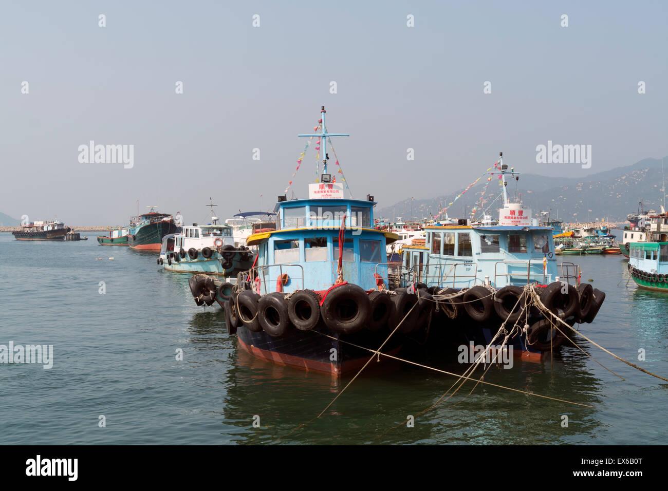Hong Kong, Hong Kong SAR -November 19, 2014: Fishing boats at Cheung Chau island Hong Kong. Cheung Chau  is a small - Stock Image
