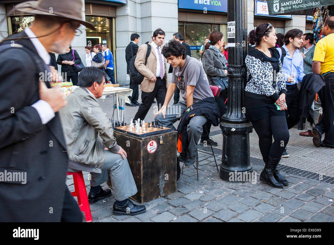 Playing chess, in Avenida Libertador Bernardo O´Higgins. Santiago. Chile. Stock Photo