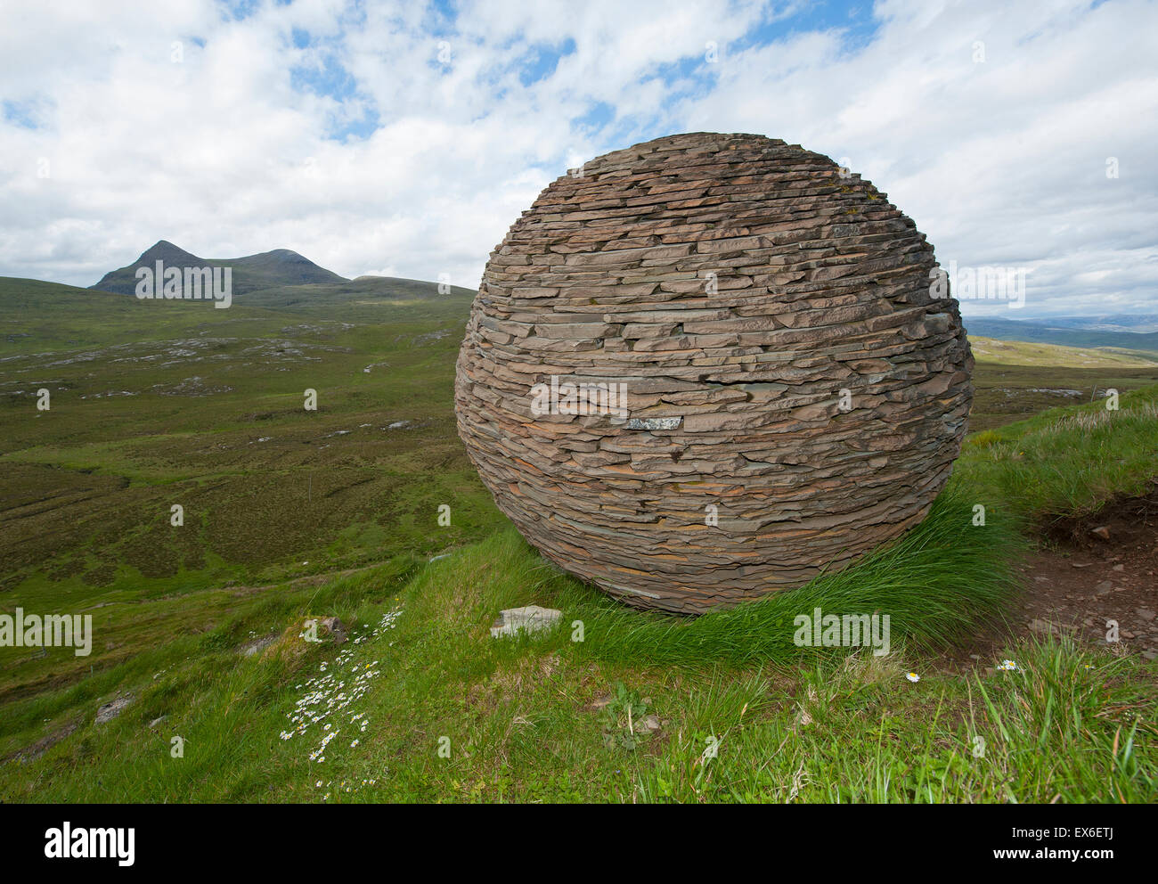 Cul Mor and the Globe artwork made by Joe Smith from Moine Shist at Knockan Crag, NW Scotland.  SCO 9907. Stock Photo