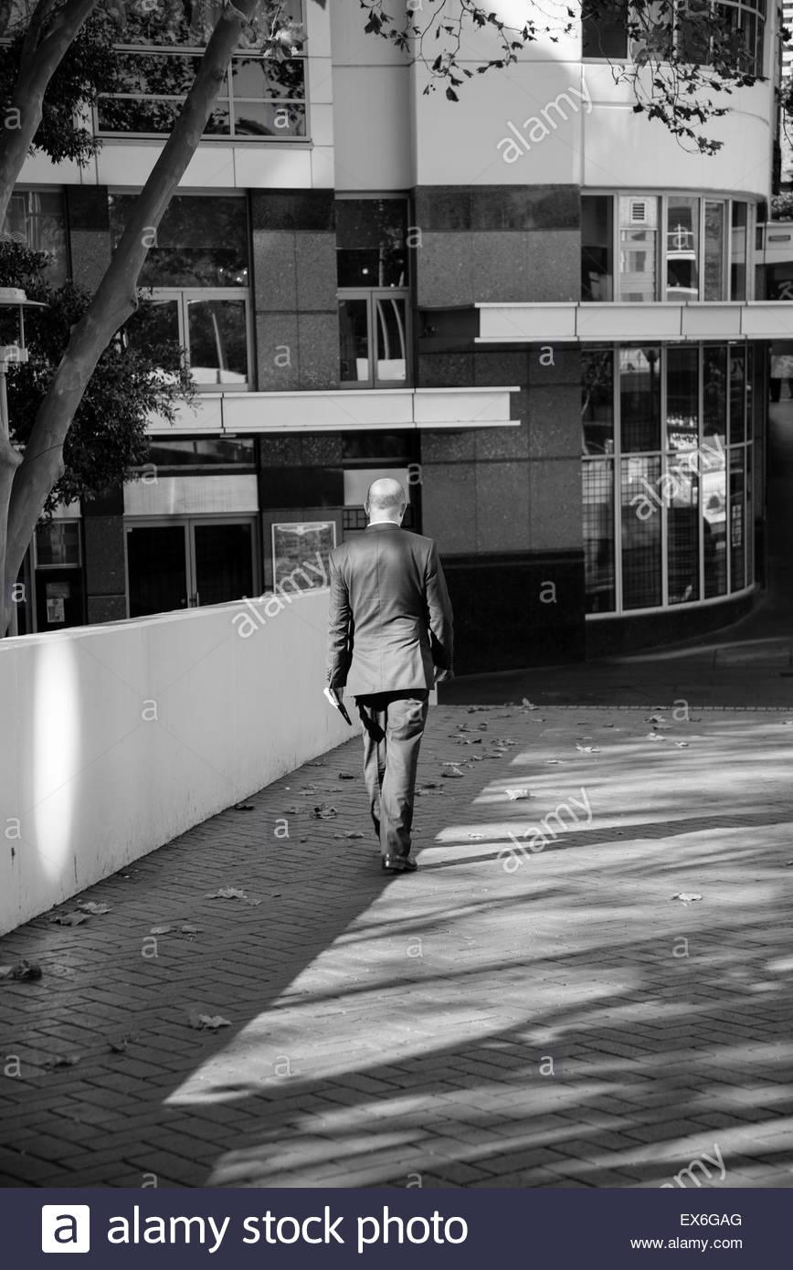 Man walking, Sydney, Australia - Stock Image