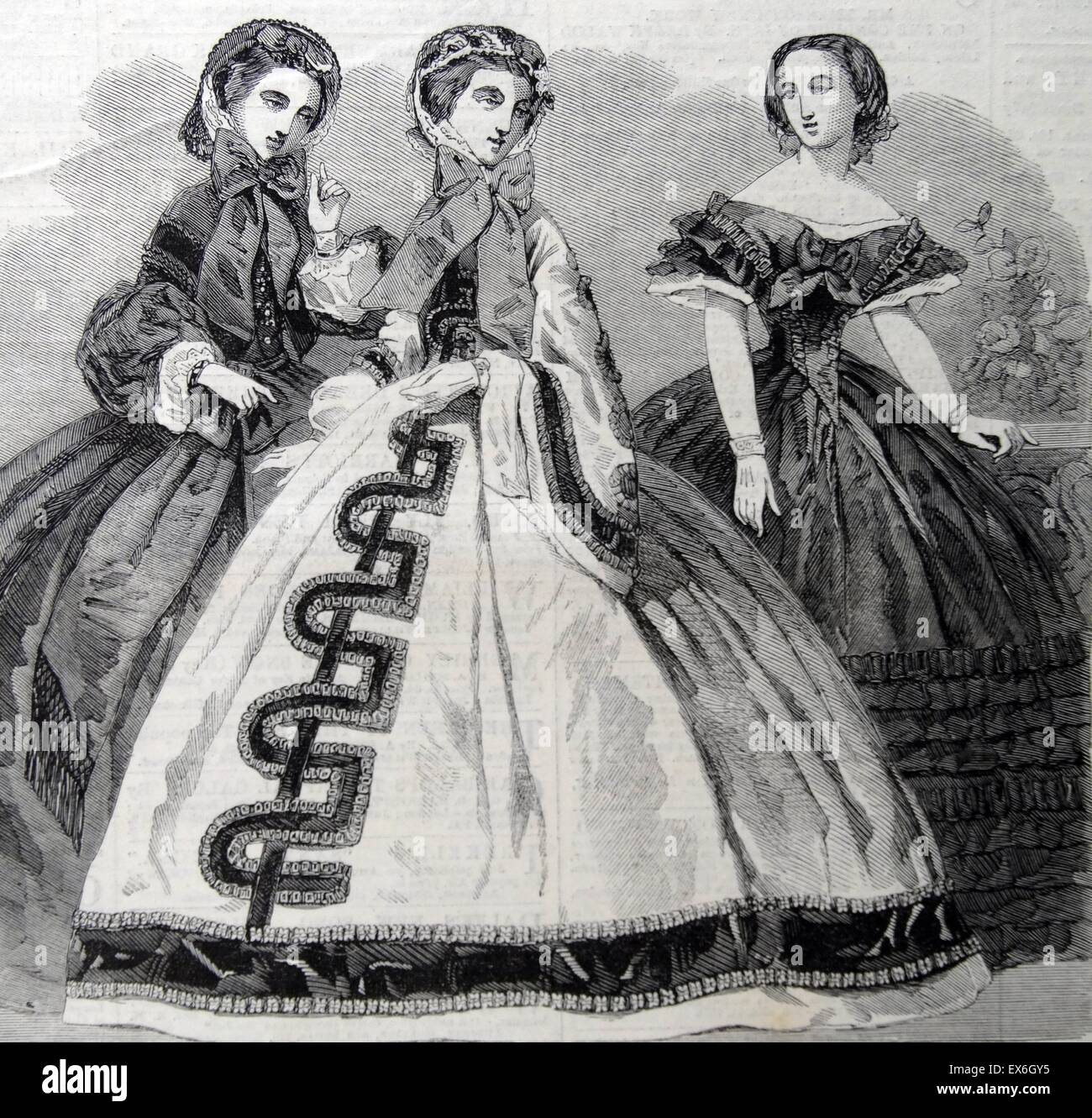 Engraving depicting the Paris Fashion for December. Left to right: Visiting Dress, Walking Dress, Evening Dress. Stock Photo
