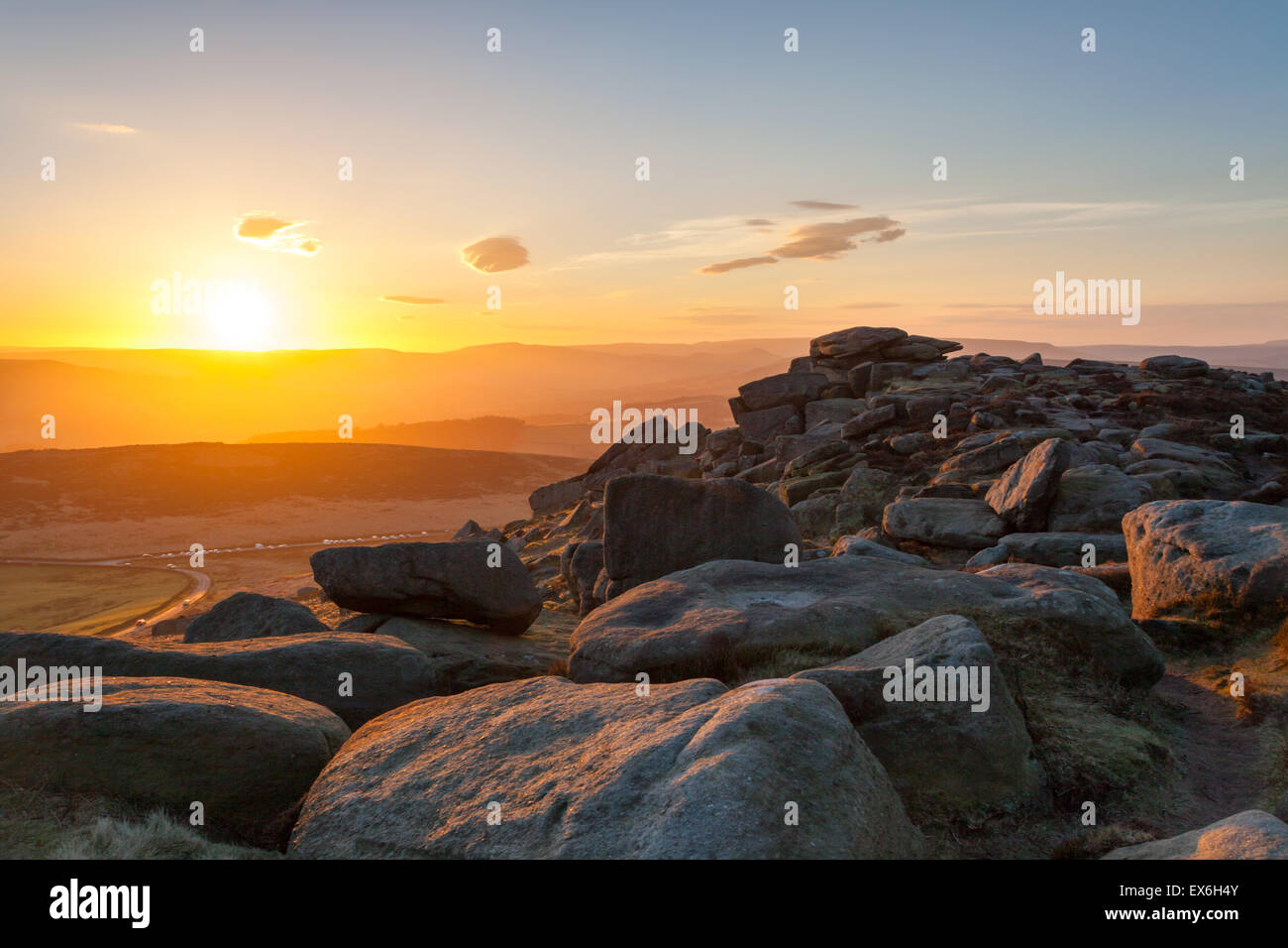 Stanage Edge Hathersage sunset over the millstone grit slabs derbyshire Peak District - Stock Image
