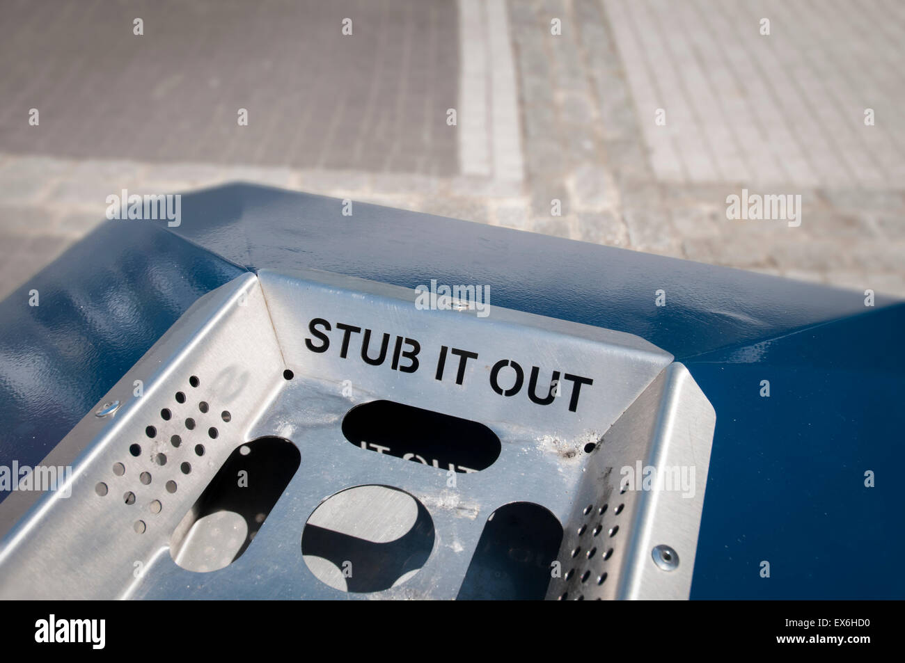 public ashtray in the street with 'stub it out' written on it. - Stock Image
