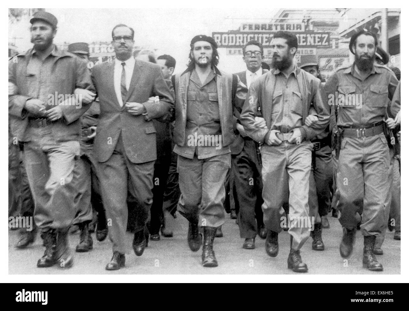 Fidel Castro Left next to Osvaldo Dorticós (President of Cuba from 1959 until 1976) with Che Guevara at a 1959 parade Stock Photo