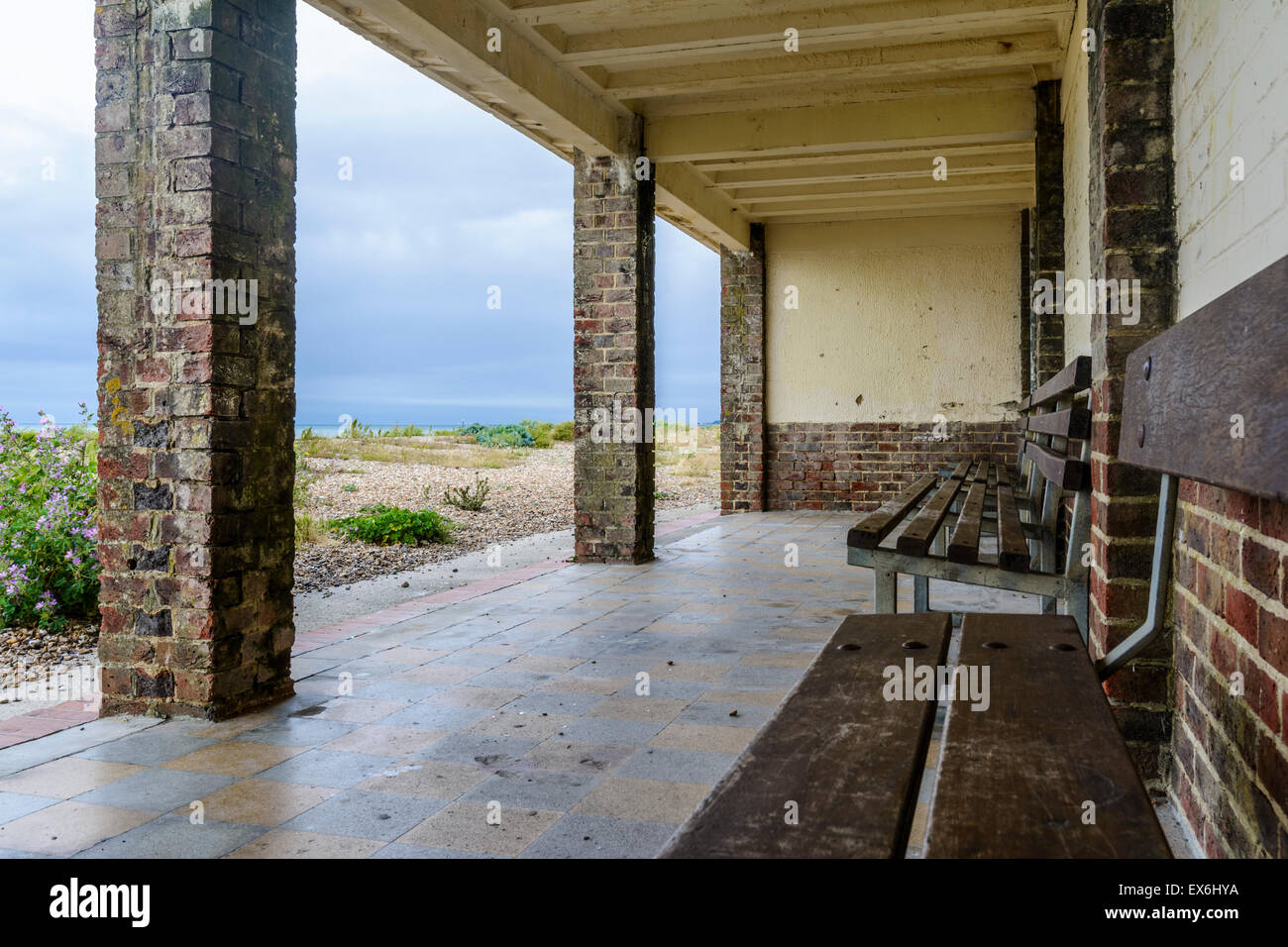 An old brick shelter on the seafront looking out to the beach and sea in Littlehampton, West Sussex, England, UK. - Stock Image