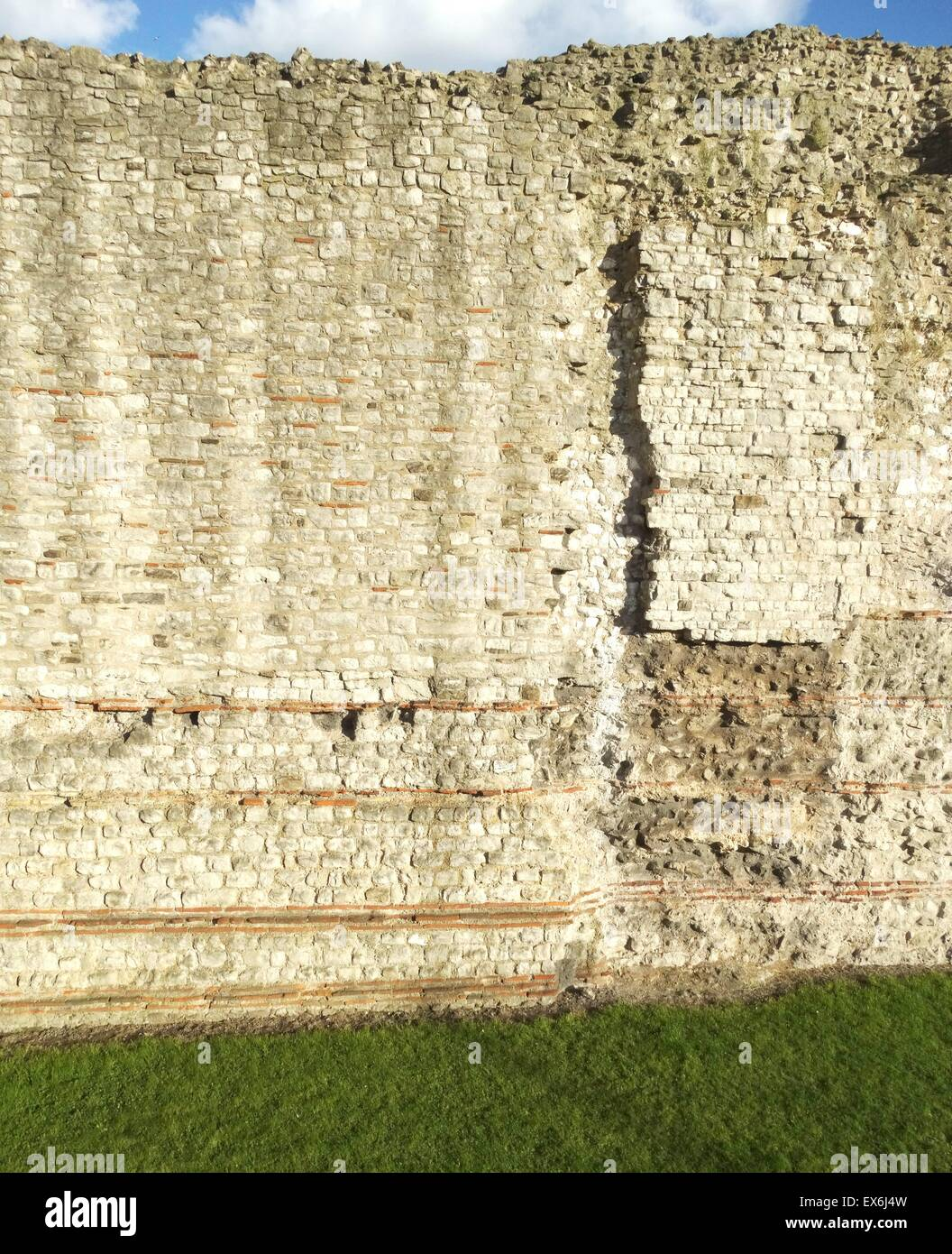 Colour photograph of London Wall, a defensive wall constructed by the Romans around Londinium. Dated 2nd Century - Stock Image