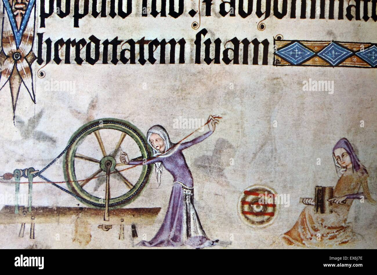 Spinning and weaving, a scene from the fourteenth-century Luttrell Psalter. From The Island Race, a 20th century - Stock Image