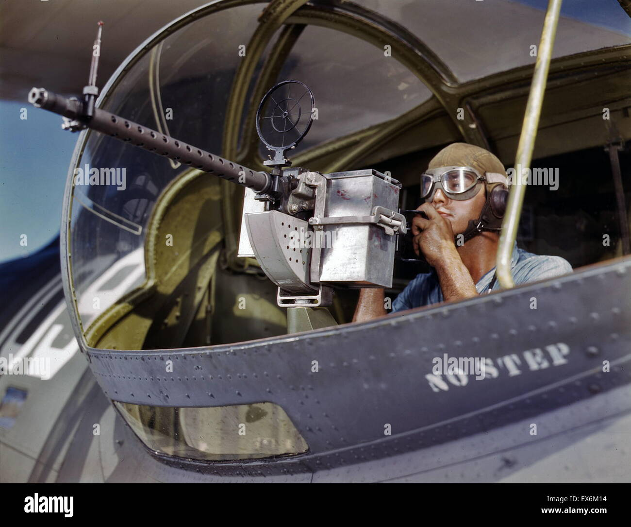 African American world war two airman, posing with a M1919 Browning machine gun next to a PBY Catalina aircraft - Stock Image